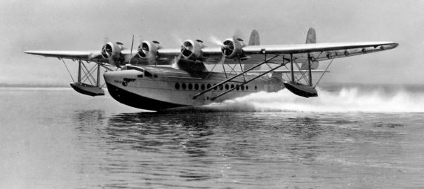 A black and white photography of a sea plane