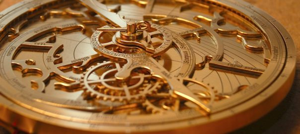 A close up picture of an astrolabe, its mechanisms exposed to the viewer.